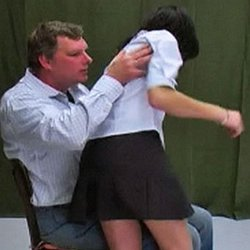 Schoolgirl spanking2. Vika knows her skirt is supposed to be fingertip length, but decides to shorten it anyway.  This act of defiance lands her in the headmasters office for some corporal punishment.  The headmaster drags Vika across his lap, lifts up her tiny skirt and gives