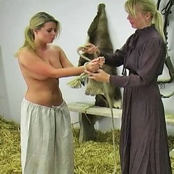 Whipping the farm girl2. Kelly forgot to feed the horses and is called into the barn to receive her lashing.  She removes her shirt, has her hands tied with rope above her head and prepares for her whipping.  Kelly cries out with every lashing and promises never forget to feed th