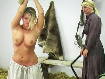 Whipping the farm girl1. Kelly forgot to feed the horses and is called into the barn to receive her lashing.  She removes her shirt, has her hands tied with rope above her head and prepares for her whipping.  Kelly cries out with every lashing and promises never forget to feed th