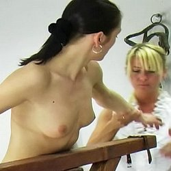 Barn whipping2. Michelle forgot to rake the hay and is called into the barn to receive her whipping.  The headmistress orders Michelle to remove her shirt, ties her to the whipping post and proceeds to give Michelle a thorough lashing.  Michelle cries out with every crac