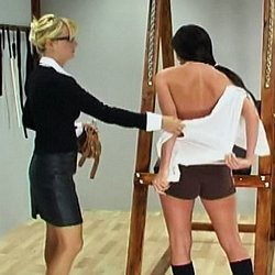 Sylvia is caught wearing too much makeup and called into the headmistress office to receive her punishment.  The headmistress orders Sylvia to remove her shirt and bra, chains her hands and uses the whip to teach Sylvia a good lesson.  Sylvia cries out wi