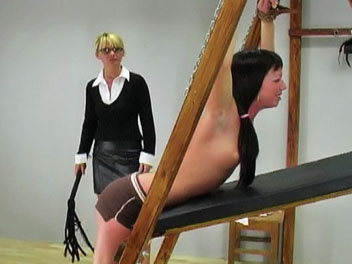 Sylvia is caught wearing too much makeup and called into the headmistress office to receive her punishment.  The headmistress orders Sylvia to remove her shirt and bra, chains her hands and uses the whip to teach Sylvia a good lesson.  Sylvia cries out