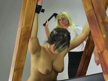 Valentine is caught out of uniform and called into the headmistress office for a thorough whipping.  Valentine lowers her orange jumpsuit, has her hands chained, and prepares for her lashing. She cries out in a mix of pleasure and pain as the headmistress