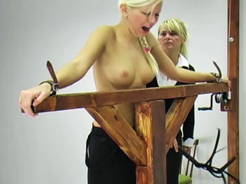 Watch as Lucie receives a stern flogging for failing her geometry test.  The headmistress lowers Lucies top, ties her the whipping post and begins the flogging session.  Lucie cries out as the whip turns her pale skin a rosy hue and promises to work harde