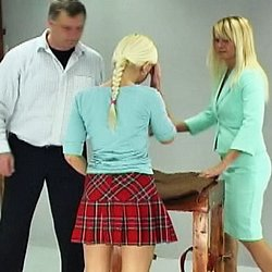 Schoolgirl caning2. Lucie has disobeyed her teacher one too many times and is called into the headmasters office for a inviting caning.  With help from another teacher, the headmaster bends Lucie over a desk and binds her arms and legs.  He lowers her panties, lifts her skirt an