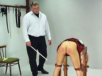Schoolgirl caning1. Lucie has disobeyed her teacher one too many times and is called into the headmasters office for a lovely caning.  With help from another teacher, the headmaster bends Lucie over a desk and binds her arms and legs.  He lowers her panties, lifts her skirt an