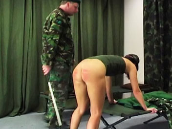 Army caning. Valerie has not made her bed according to army regulations and receives a beautiful caning from her taskmaster.  He orders her to remove her pants and underwear and bend over the bed in preparation for her caning.  Valerie cries out in pain as the taskmasters