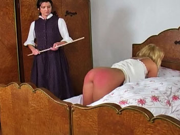 The headmistress is tired of Kellys lazy ways and wakes her up with a few spanks with her cane.  The headmistress orders Kelly on all fours, lifts up her nightgown and uses her cane to turn Kellys bottom a lovely shade of pink.  Kelly cries out in a mix o
