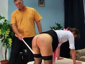 Keira has failed to finish her chores and is punished for her disobedience in this caning film.  The taskmaster orders Keira remove her panties and bend over the table in preparation for her caning.  He then lifts her skirt and uses his cane to teach