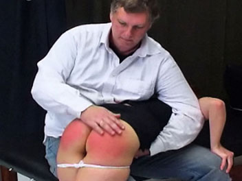 Saras slutty outfits have finally landed her in the headmasters office.  He gets one look at her tight black skirt and knee high boots and immediately orders her to lie across his lap for a good old fashioned spanking.  He smacks her ass a few times over