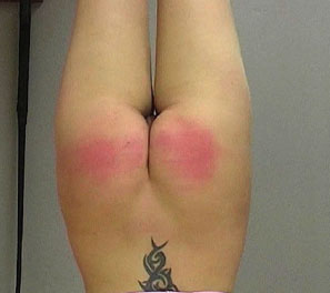 Shannon was hoisted upside down completely helpless.  She had recently gotten a tattoo on her back like so many other German school girls. It is because of this, she was declared to have her tender and soft ass viciously hurt, with a hard paddle beating h