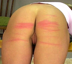 Joan was strapped into our paddling device, but this time we felt we should change it up by using a whip instead.  She was in a perfect position to have her beautifully plump ass be whipped red.  Her marks were more red then the sweet pussy lips hidden be