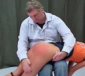 A soft touch. Occasionally the headmaster will go wild with need to punish his students for things he felt they will eventually commit.  He decided on Trisha, since she had the longest history amongst the girls, in terms of violations.  He had her bent over his leg, an