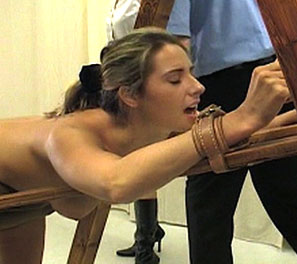 In todays corporal punishment video, Helen is strapped into a medieval contraption, exposing her soft fleshy bottom to the stiff and painful blows of a heavy cane.  Helen had sneaked out of the all girls school to go to a party held near by, but was caugh