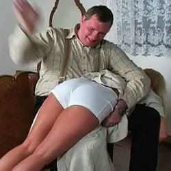 Kelly has failed to do her chores around the house and knows she will be punished for it.  The taskmaster grabs her by the arm, throws her over his knee and begins to pummel her behind with his strong hand.  He lifts up her skirt, pulls down her panties a
