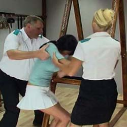 Upended to expose her bum to brutal punishment, she